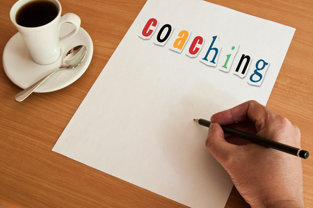 paper art projects: concept office cup of coffee and word coaching on white page Stock Photo