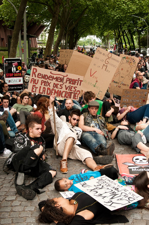 against the current: STRASBOURG  France  23 May 2015  people sitting on the road during the demonstration against Monsanto and the transatlantique treated for the production of GMO in Europe Editorial