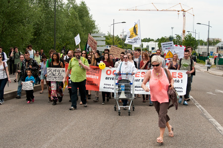 against the current: STRASBOURG  France  23 May 2015  people  during the demonstration against Monsanto and the transatlantique treated for the production of GMO in Europe