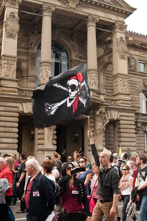 against the current: STRASBOURG  France  23 May 2015  people with flags during the demonstration against Monsanto and the transatlantique treated for the production of GMO in Europe