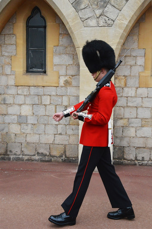 LONDON  ENGLAND JUNE 02 2015 :Buckimgam Palace   The Queen's Guard is the contingents of infantry and cavalry soldiers charged with guarding the official royal residences.