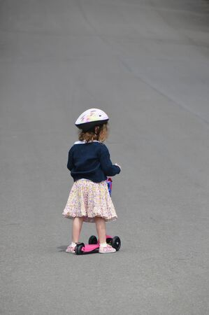 mini bike: little girl with mini bike on the road Stock Photo