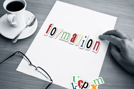 paper art projects: concept office cup of coffee and word formation on white page