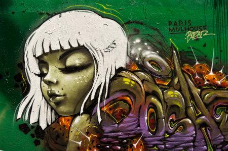 sinners: MULHOUSE  France  07 June 2015  graffiti of woman during the BOZAR  graffiti festival  quay of sinners in Mulhouse