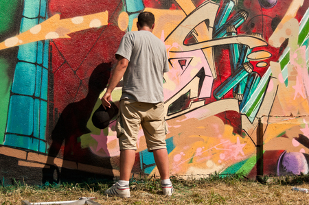 sinners: MULHOUSE - France - 07 June 2015 - painter during the BORAR  graffiti festival - quay of sinners in Mulhouse Editorial