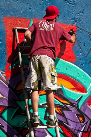 sinners: MULHOUSE  France  07 June 2015  painter during the BOZAR graffiti festival  quay of sinners in Mulhouse