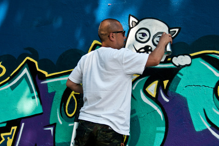 sinners: MULHOUSE  France  07 June 2015  painter during the BORAR  graffiti festival  quay of sinners in Mulhouse