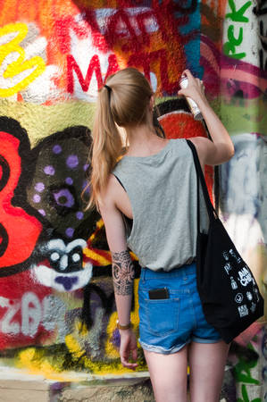 sinners: MULHOUSE  France  07 June 2015  painter woman during the BOZAR  graffiti festival  quay of sinners in Mulhouse