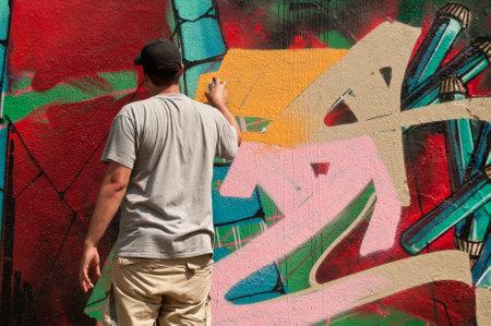 sinners: MULHOUSE  France  07 June 2015  painter artist during the BOZAR graffiti festival  quay of sinners in Mulhouse