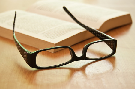 glasses on a book closeup Stock Photo