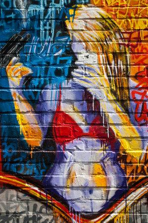 sinners: MULHOUSE  France  08 June 2015  graffiti of woman with shotgun  during the BOZAR graffiti festival  quay of sinners in Mulhouse