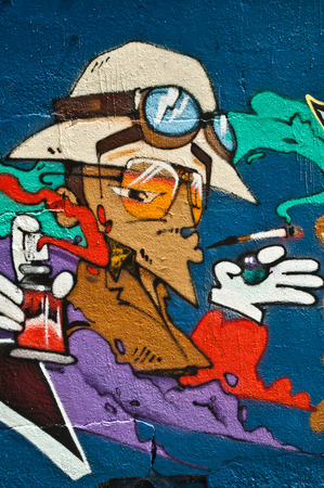 sinners: MULHOUSE  France  08 June 2015   graffiti of character during the BOZAR graffiti festival  quay of sinners in Mulhouse