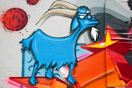 sinners: MULHOUSE - France - 08 June 2015 - graffiti of an angry goat during the BOZAR graffiti festival - quay of sinners in Mulhouse