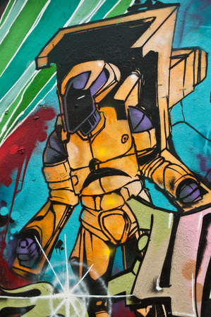 sinners: MULHOUSE  France  08 June 2015  graffiti of cosmos character during the BOZAR graffiti festival  quay of sinners in Mulhouse