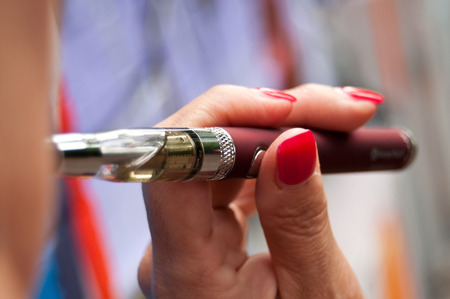 closeup woman with e-cigarette