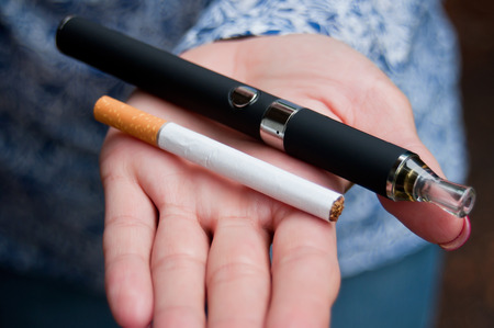 woman stop: closeup hand of woman with e-cigarette