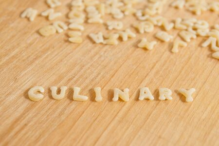 culinary: Alphabet pasta forming the text culinary