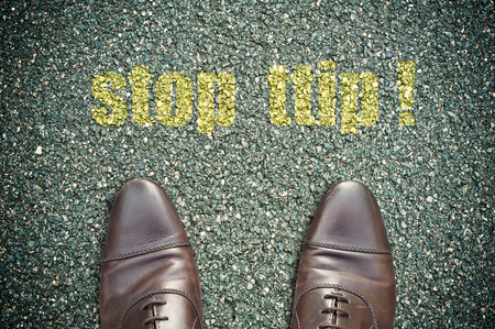 signage: concept signage on the road with feet - stop ttip !