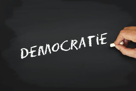 yes or no to euro: concept writing with chalk on blackboard - democratie democraty in french Stock Photo