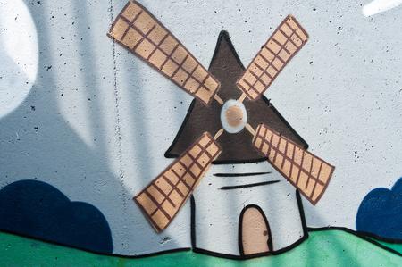 holand: BOLLVILLER - France - 13 August 2015 - graffiti of windmill