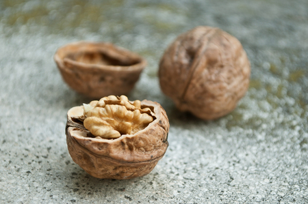 stoned: group of walnuts on stoned background