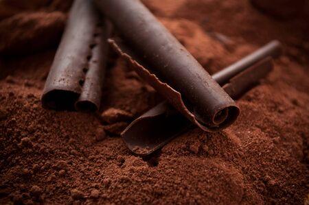 chocolate powder: chocolate shavings on chocolate powder background Stock Photo