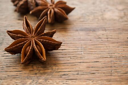 christmas perfume: Dried anise  on wooden  background Stock Photo