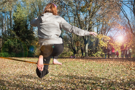 slack: MULHOUSE - France - 11 November 2015 - tightrope walker between two trees