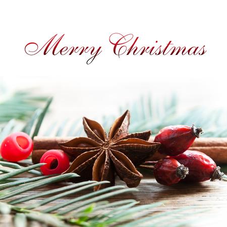 christmas perfume: merry christmas card with decorative anise cinnamon and dog rose Stock Photo