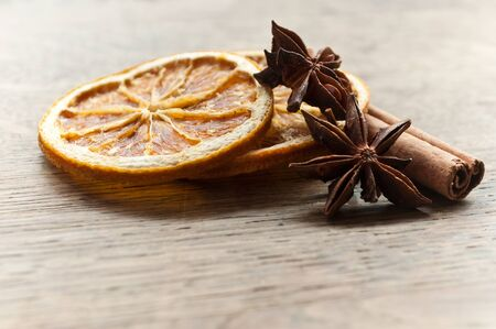 christmas perfume: closeup of sliced orange with  dried anise and cinnamon
