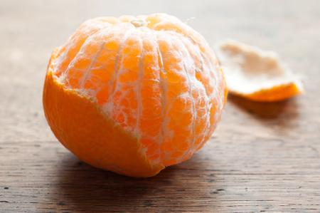 peeled: peeled  tangerine on wooden background Stock Photo