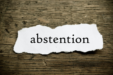abstention: Concept  message on paper on wooden desk background - abstention Stock Photo