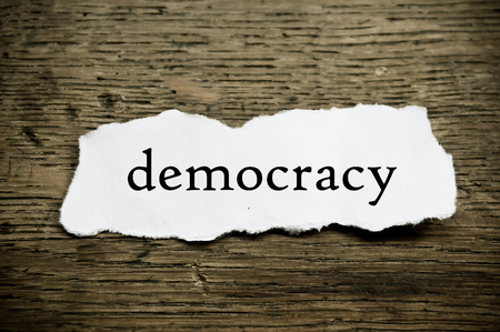abstention: Concept  message on paper on wooden desk background - democracy Stock Photo
