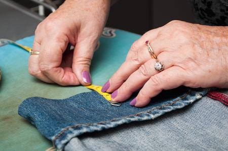 closeup of woman with blue jeans hem Standard-Bild