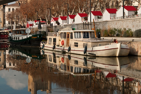 touristic: Narbonne - France - 23 december 2015 - quay with touristic boats