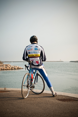 sponsors: Valras - France - 21 December 2015 - cyclist with sponsors in border sea