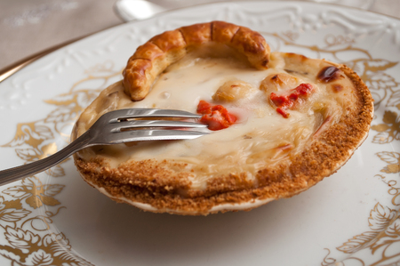 coquille: Coquille St. Jacques seafood in scallop shells with fork