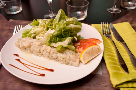 st jacques: tartare of St Jacques with salad in a plate Stock Photo