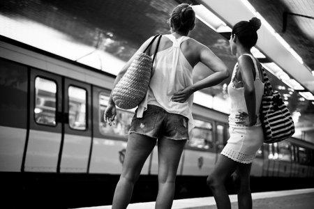 metropolitan: PARIS - France - 26 July 2015 - Woman waitin in parisian metropolitan