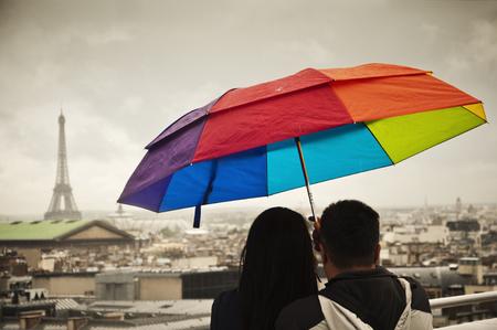 rainbow umbrella: tourists in Paris with rainbow umbrella Stock Photo