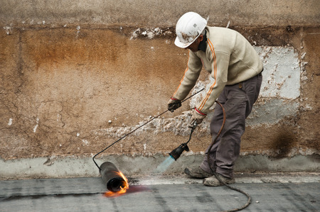 blowpipe: worker on construction site with blowpipe