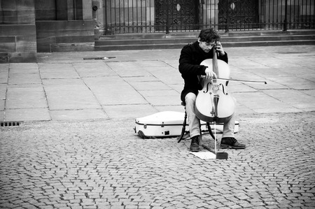 cellist: STRASBOURG - France - 12 February 2016 - cellist alone in place Editorial