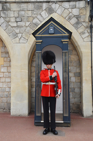 residences: LONDON - ENGLAND JUNE 02 2015 : windsor castle - The Queens Guards are the contingents of infantry and cavalry soldiers charged with guarding the official royal residences.