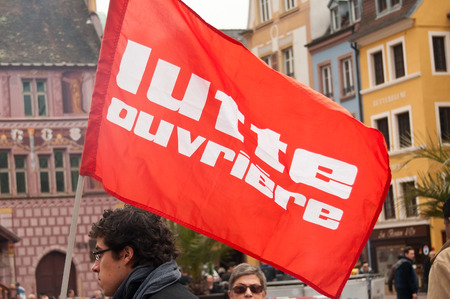 misery: MULHOUSE - France - 2 April 2016 - people with flags during the demonstration against misery and poverty - workers struggle (text in french)