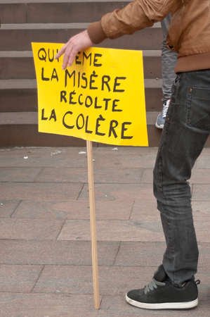 misery: people with banner during the demonstration against misery and poverty - who sows misery reaps rage Editorial