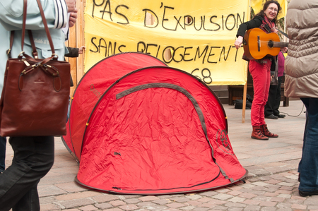 misery: MULHOUSE - France - 2 April 2016 - people with banner during the demonstration against misery and poverty - no eviction without rehousing (text in french)