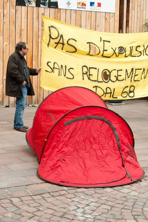 against the current: MULHOUSE - France - 2 April 2016 - people with banner during the demonstration against misery and poverty - no eviction without rehousing (text in french)