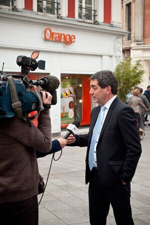 interviewed: MULHOUSE - France - 21 April 2016 - Jean Rottner the mayor of Mulhouse interviewed by television at opening of Starbucks in Mulhouse
