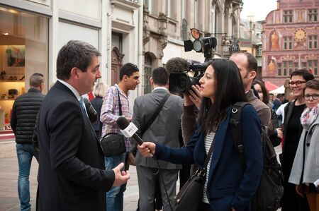interviewed: MULHOUSE - France - 21 April 2016 - Jean Rottner the mayor of Mulhouse interviewed by france television at opening of Starbucks in Mulhouse