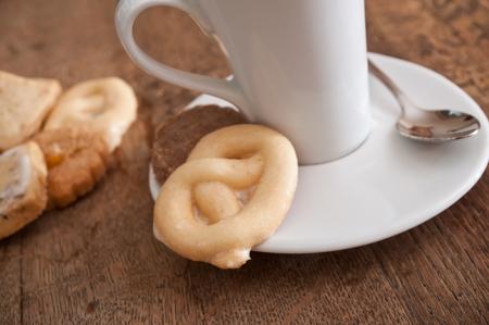 alsatian: closeup of alsatian cookies and cup of coffee on wooden background